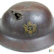 Front view of a helmet with a bullet hole in it