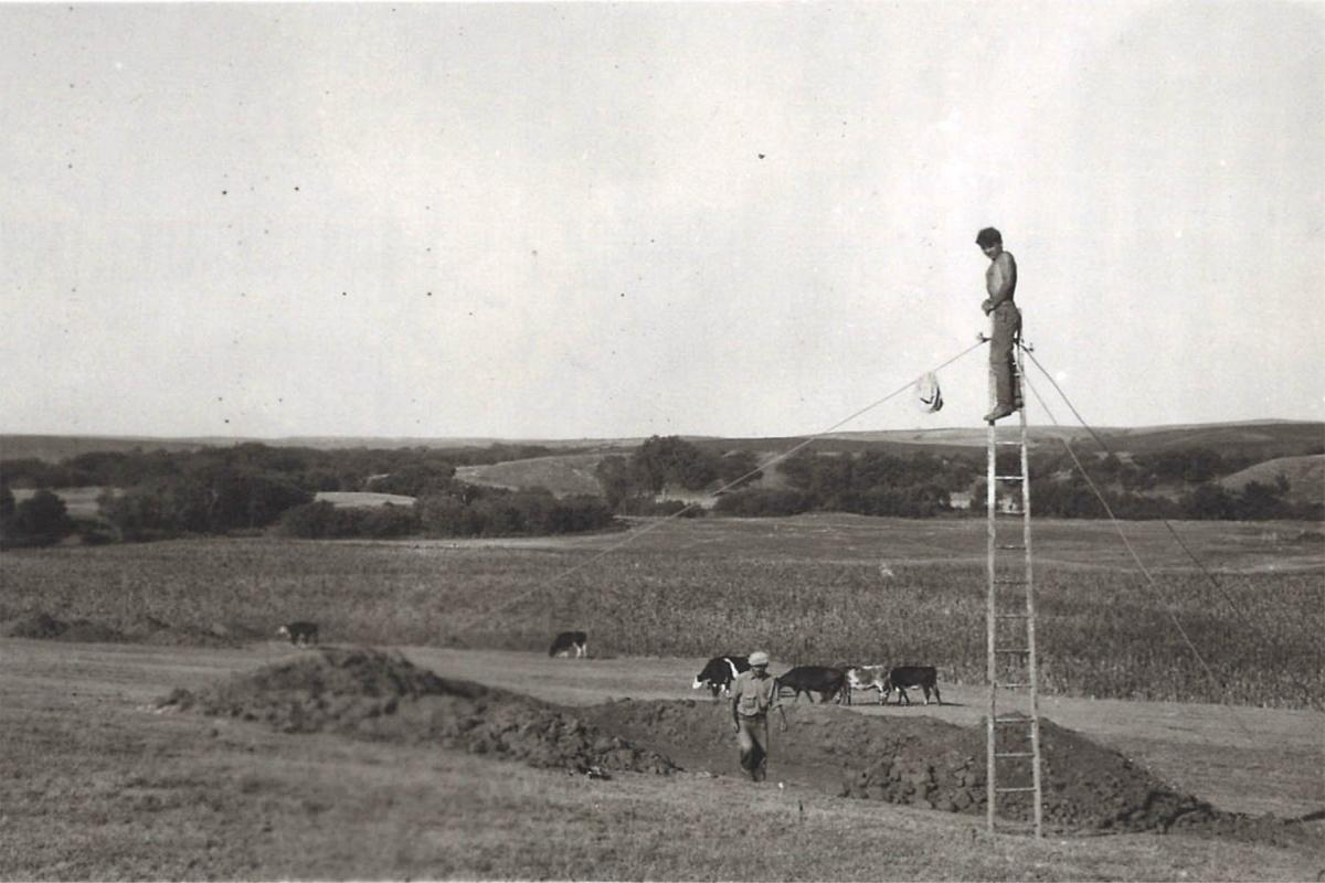 Capturing overhead photos of an excavation at a Central Plains Tradition Village in Greeley County 1939, 25GY4-39