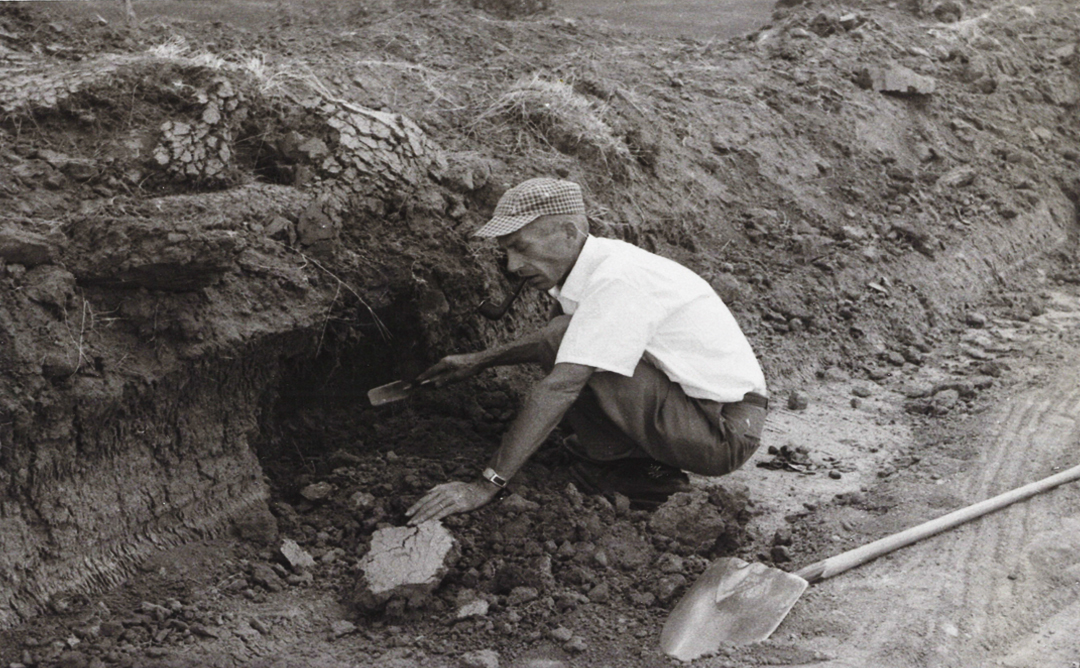 Marvin Kivett excavating a shallow pit in Nance County 1959