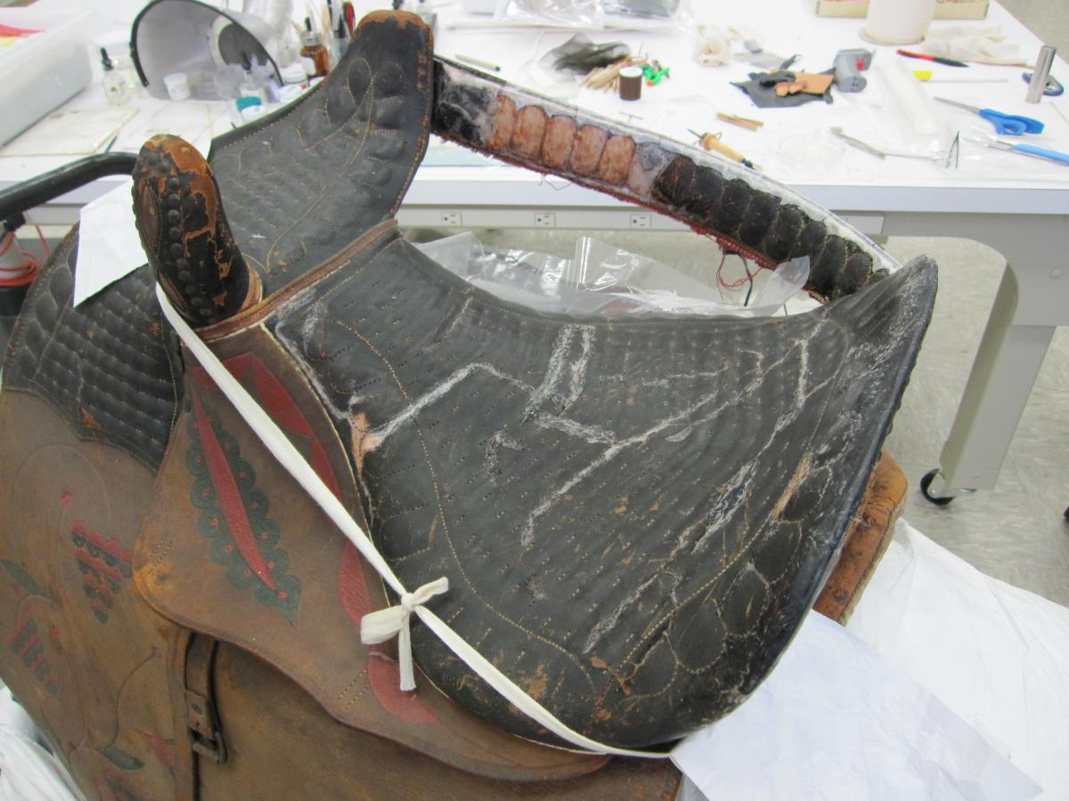 Top of saddle seat showing goldbeater's skin repairs to cracks and losses
