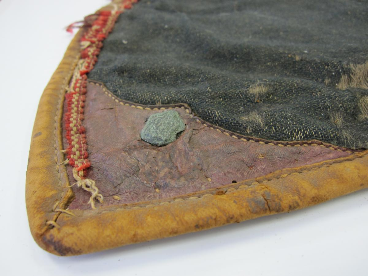 Repair to leather corner of saddle blanket after inpainting