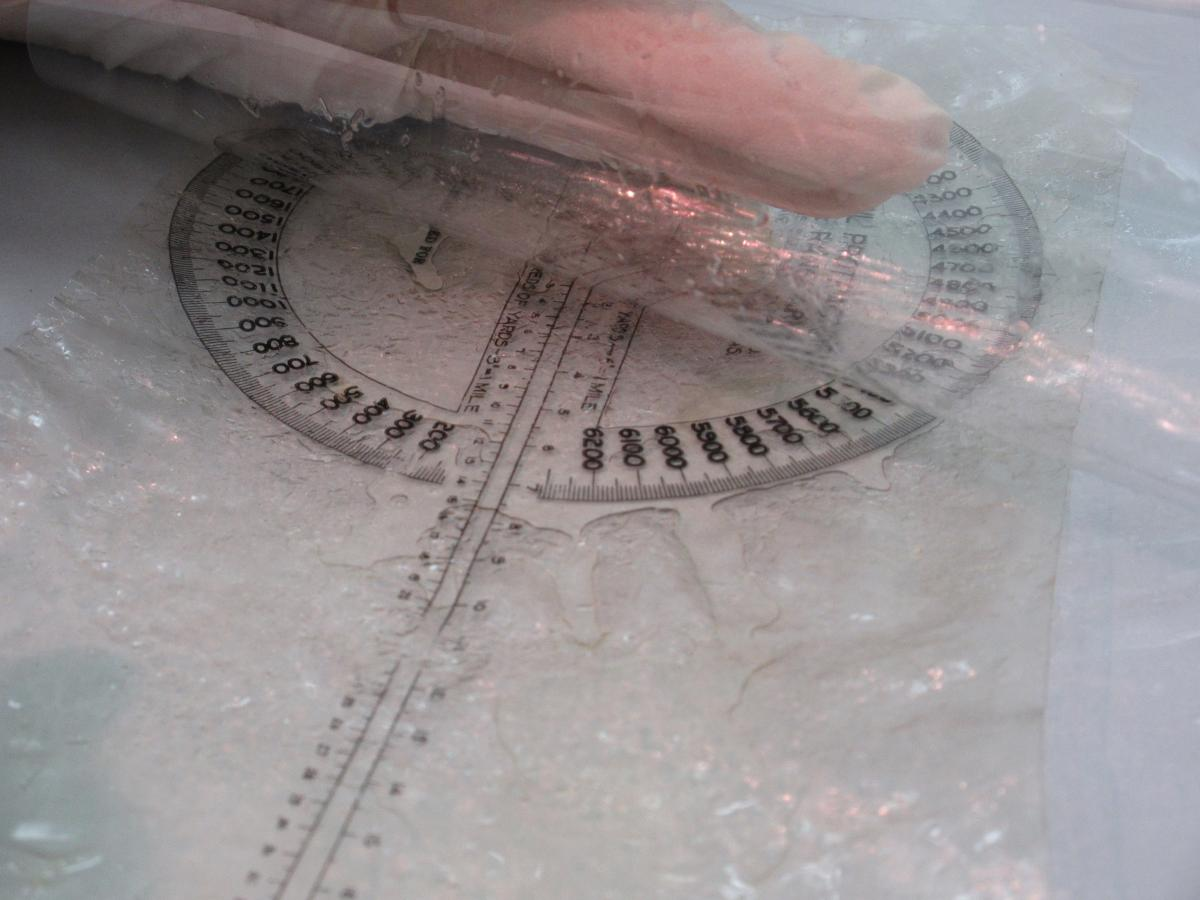 Celluloid Protractor with liquid leaking out