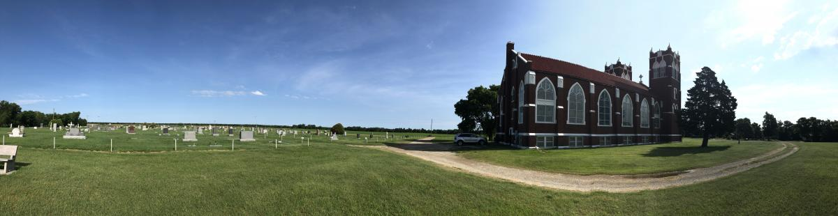 panoramic photo of brick church on the open plains