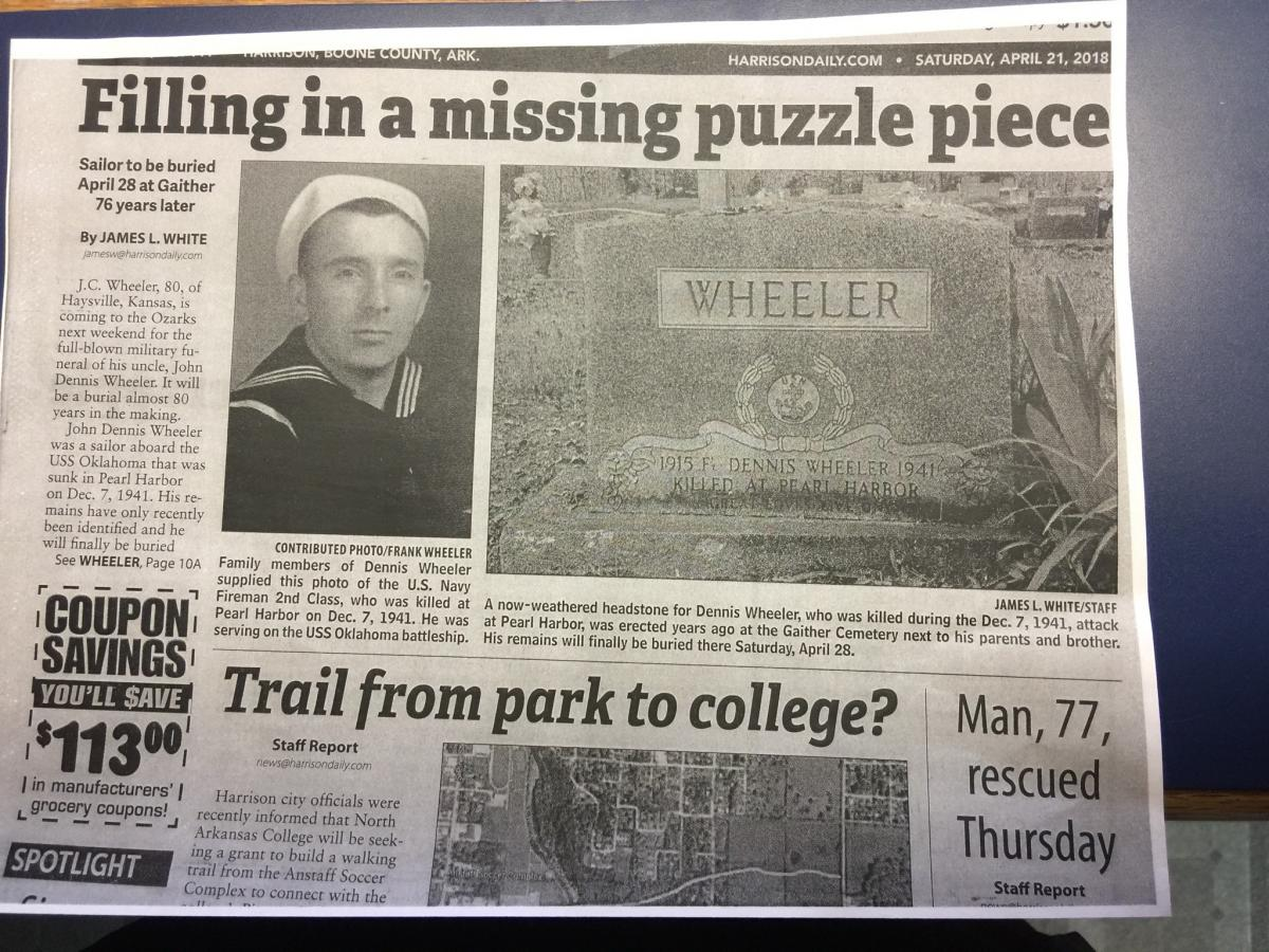 Newspaper clipping showing photo of John Dennis Wheeler and photo of headstone.