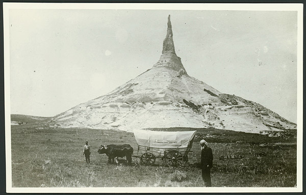 photograph of Chimney Rock, Ezra Meeker, two oxen and a dog from 1906