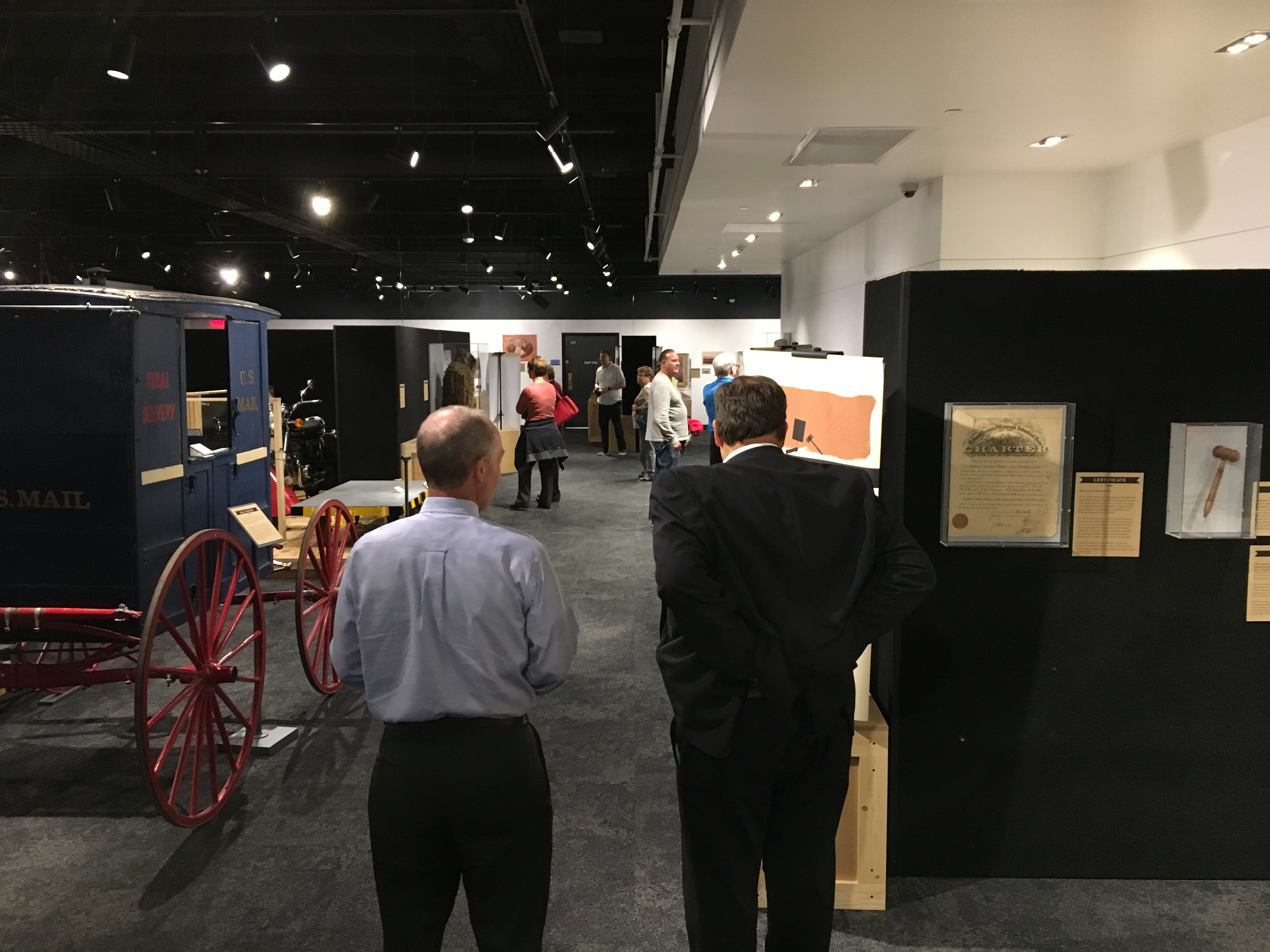 Visitors looking at museum exhibits