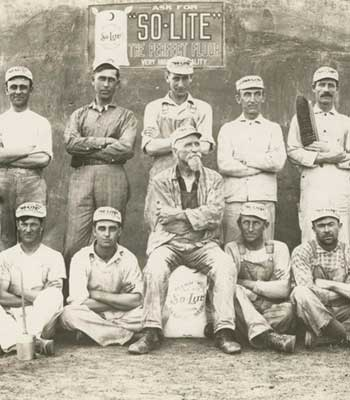 Old photo of a group of mill workers